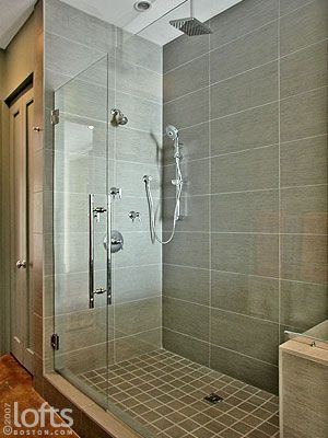 Rectangle Tile Shower Stall Designs  shower heads and a separate handheld sprayer give the