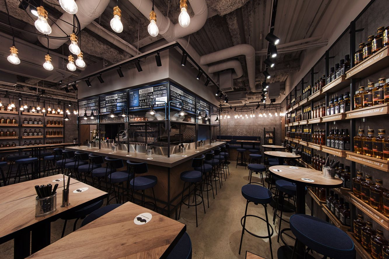 from the rounded entrance the bustling atmosphere of interior can spill out onto the street the l shaped highball serving counter and whiskey bottle