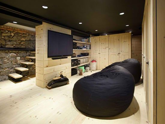 Fun And Rustic Basement Playroom With Unfinished Wood Black Bean Bags TV