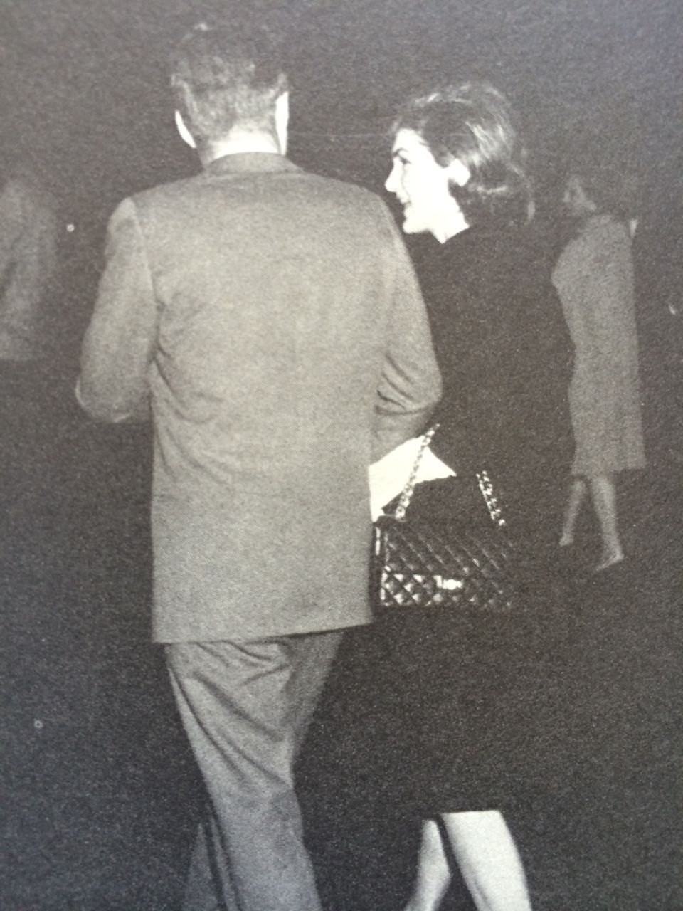 President Kennedy walks with his wife Jacqueline from her return from India.