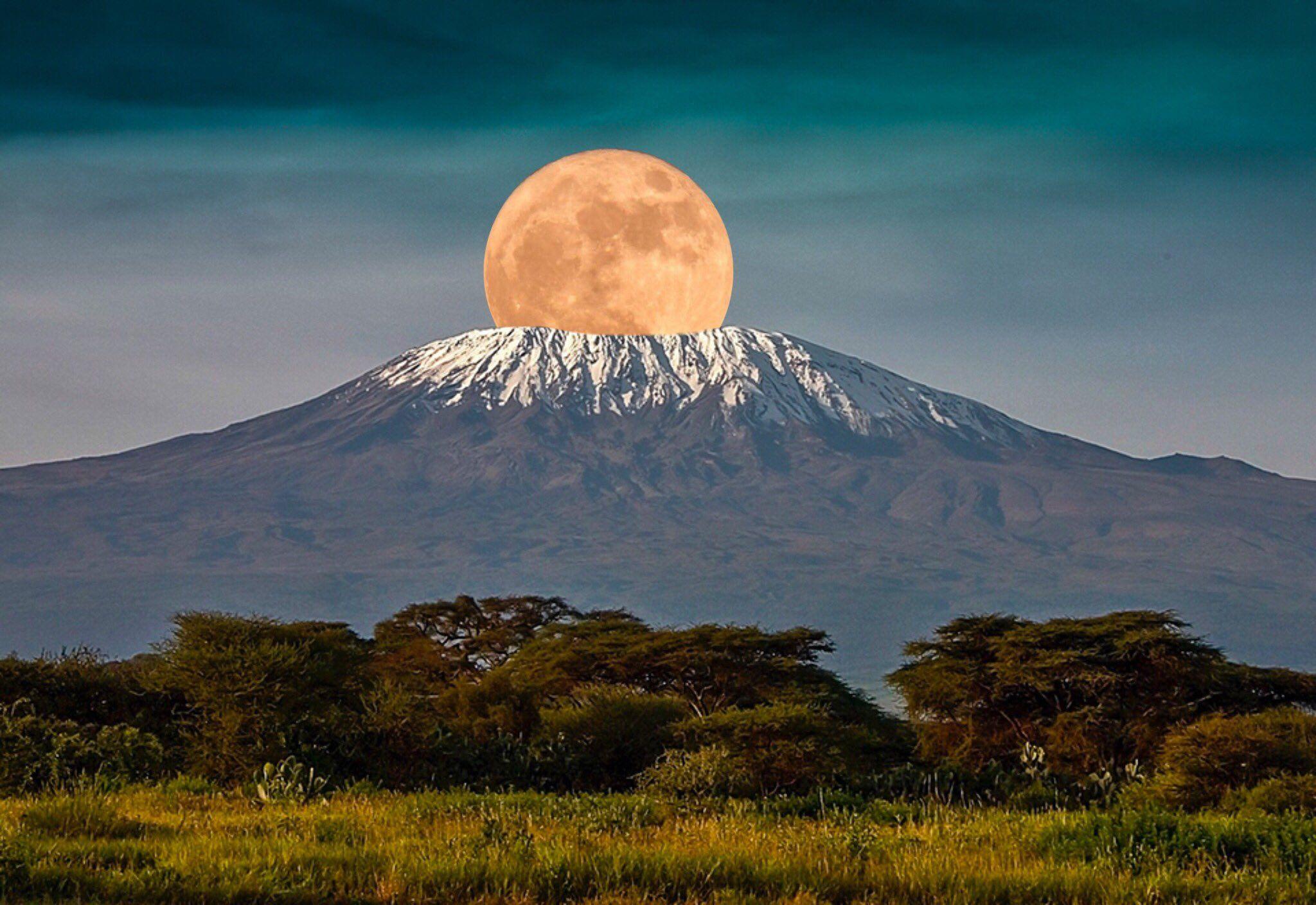 The full moon rises over Mount Kilimanjaro, Tanzania, Africa