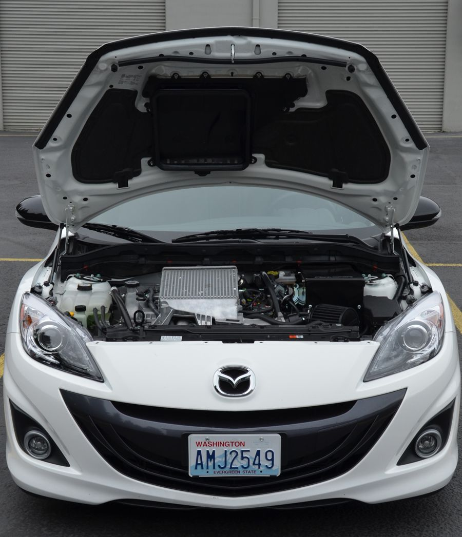 Lift the hood of your mazdaspeed 3 with the corksport hood strut lift kit