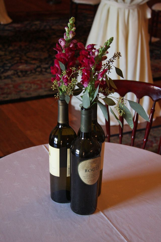 Recycled wine bottle centerpieces with cranberry for Clear wine bottle centerpieces