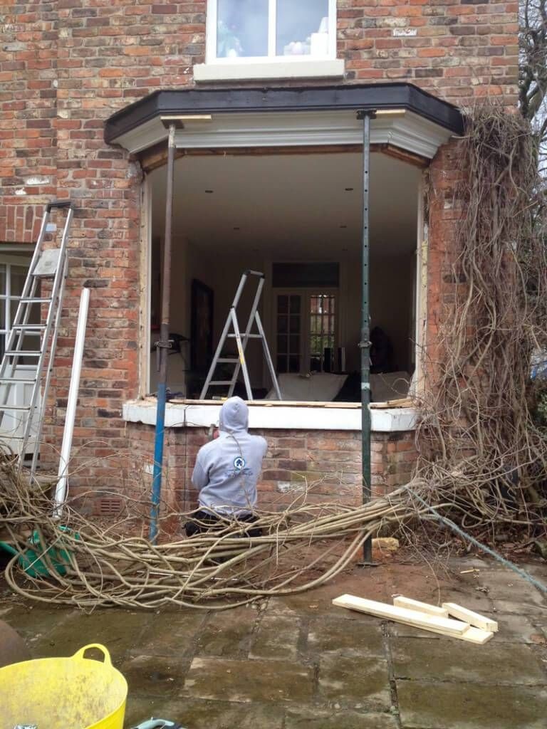 Period property convert bay window into French Doors
