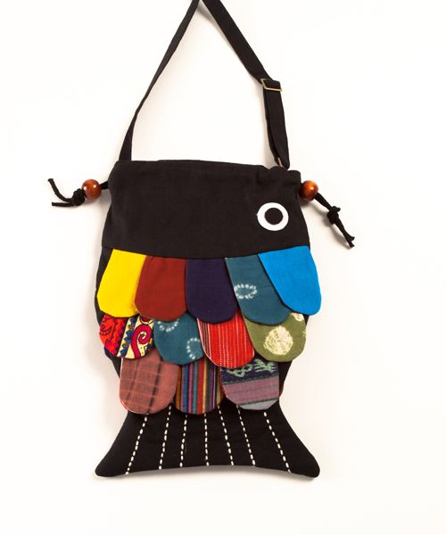 """$19    BRAND: peppercorn    Get set for adventure with this one of a kind fish. Unique Artisan work inspired by nature. Beautiful clothing accessory and gift. Adjustible shoulder strap and drawstring closure. Low impact eco-friendly dyed canvas. Size: 9"""" x 13"""". Decoration may vary. Imported."""