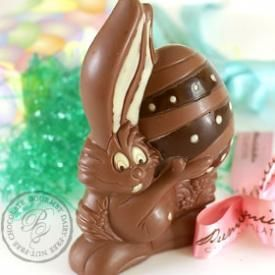 Easter bunny holding a decorated egg a chocolate easter easter bunny holding a decorated egg easter gift basketschocolate bunny vegan negle Images