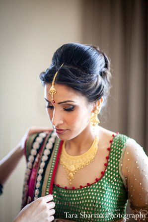 traditional Indian bun wedding hairstyle with maang teeka