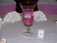 Many styles of glass candle centerpieces  : add a touch of color with colored crystals or stones