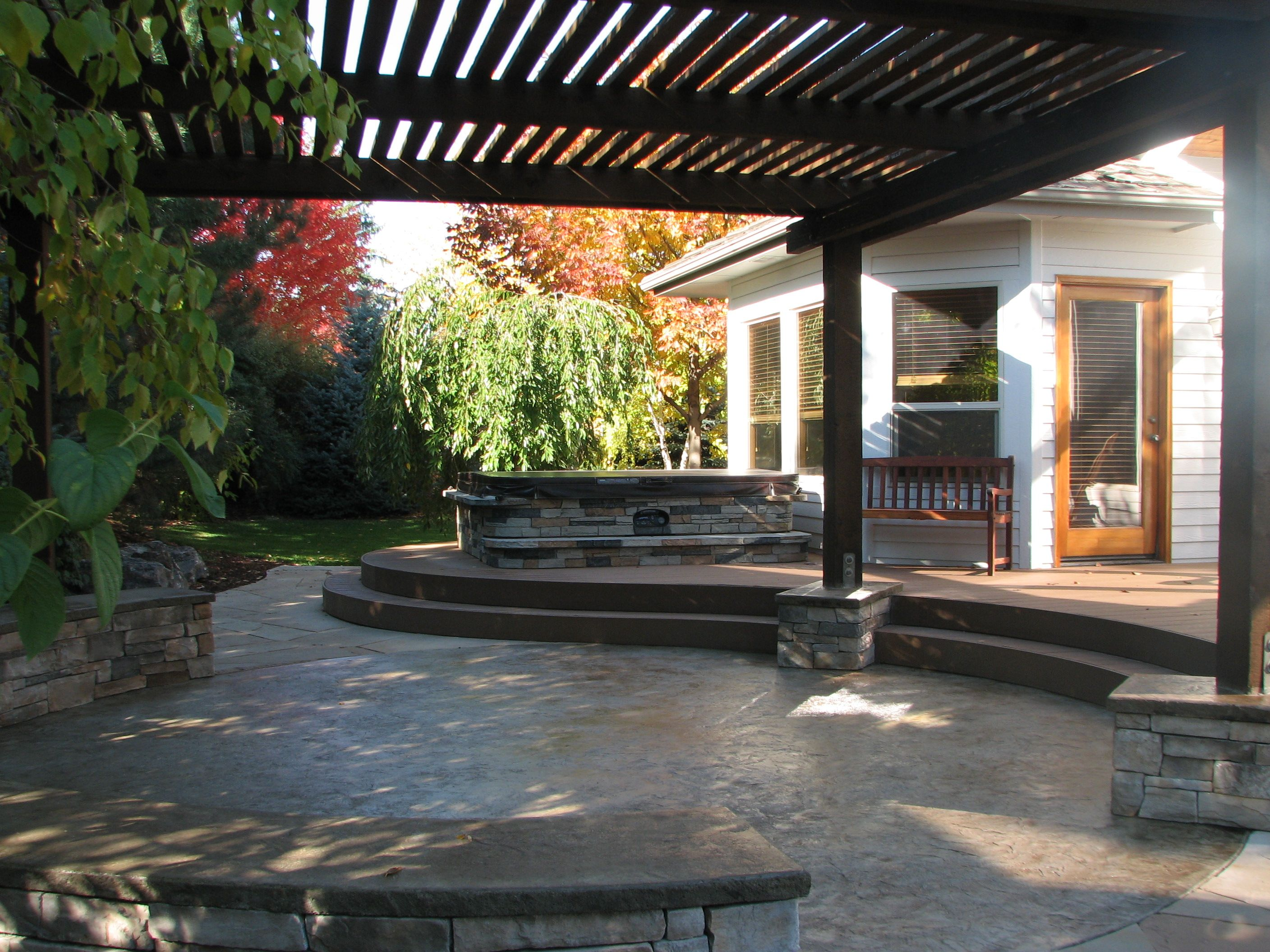curved deck, patio, hot tub and timber shade structure | landscape ... - Patio Shade Structure Ideas