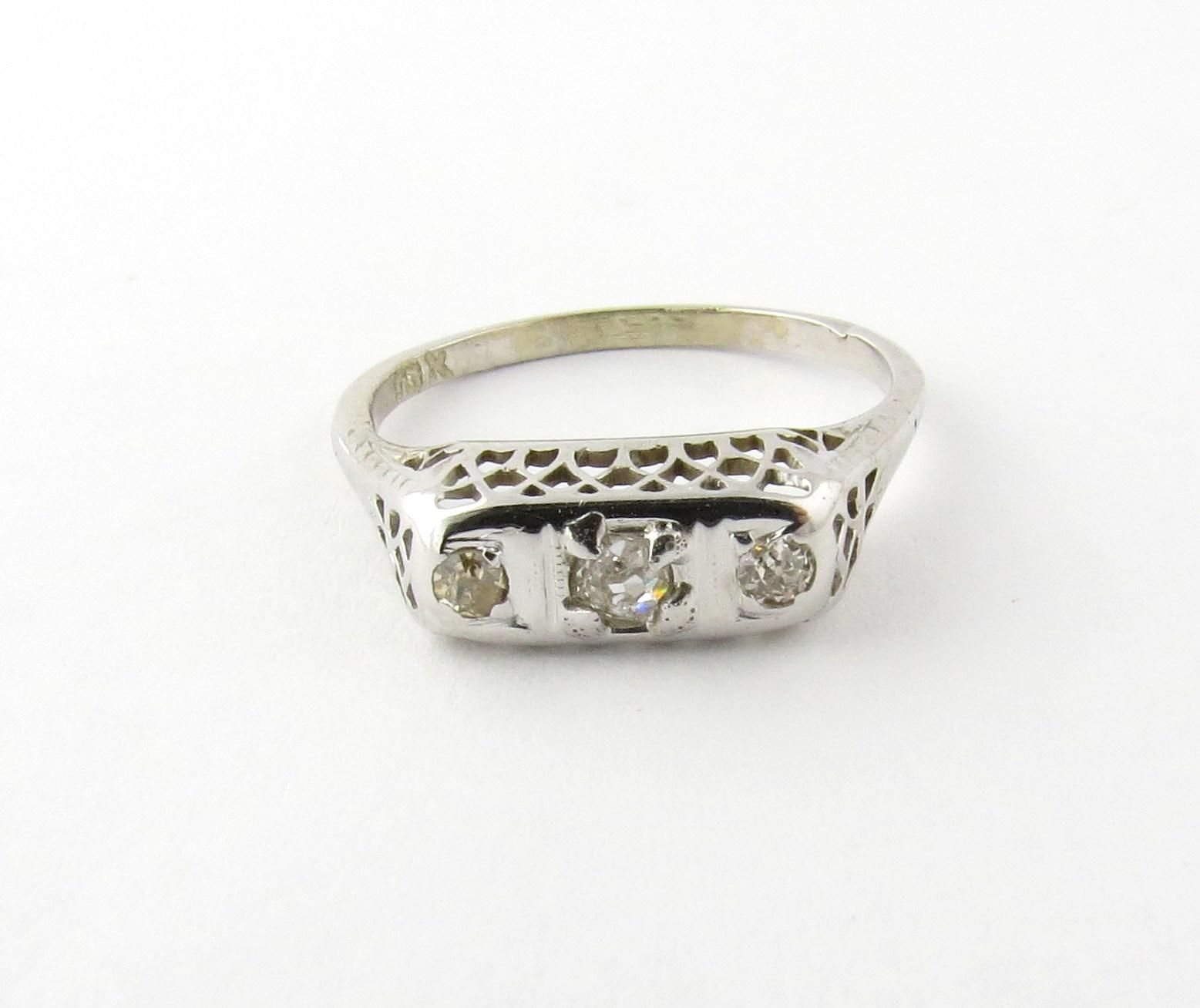 Antique 18K White Gold Filigree 3 Old Mine Diamond Ring  Size 6.5 This diamond ring has a rectangular filigree front design set with 3 old mine
