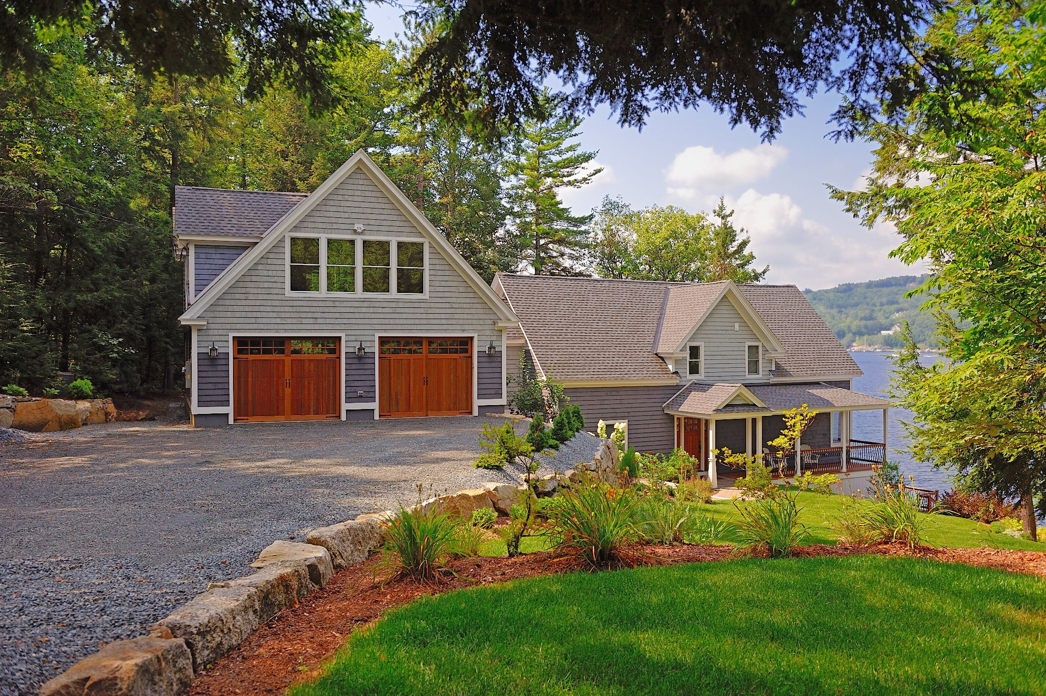 A Sense Of History Underlies C H I S Wood Garage Doors Shown Is Model 5400 With Optional Stockton Windows Wood Garage Doors Carriage House Garage Doors House