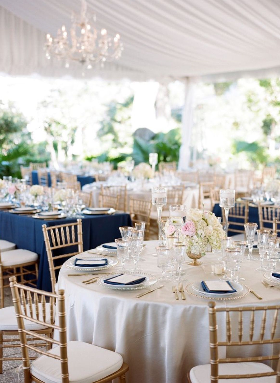 Potentially navy and shimmery gold/champagne table cloths instead of ...