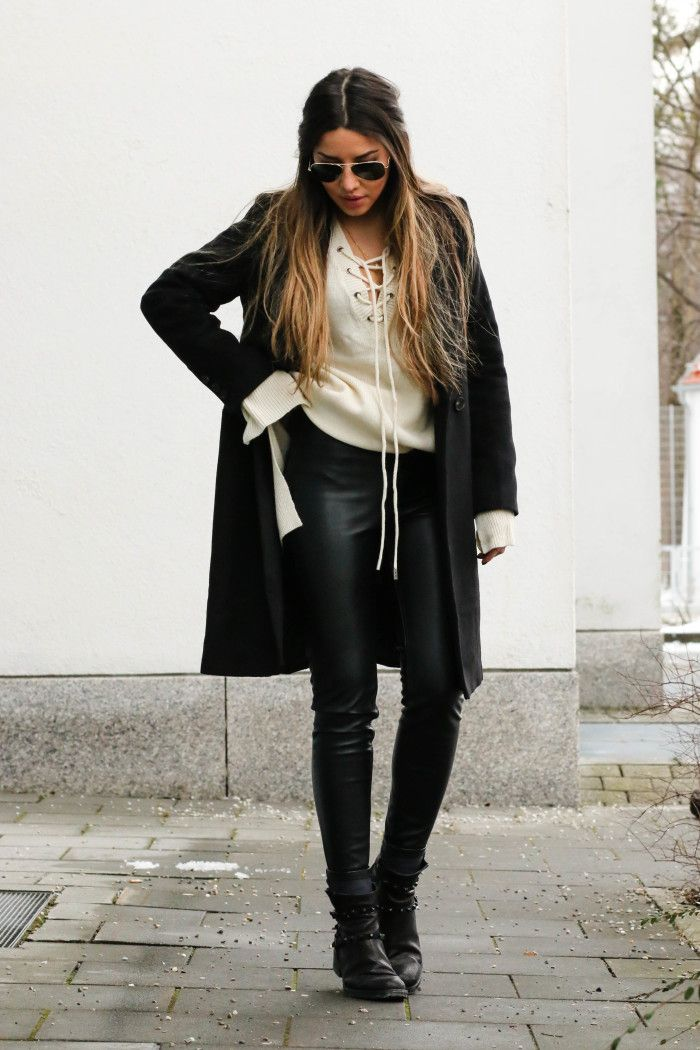 Consuelo Palomais wearing a strikingly stylish lace up knitted blouse, paired with leather leggings and a sleek black overcoat. This outfit also includes the extra long sleeves trend; overall a hugely inlook!Sweater/Jacket: Shein, Trousers: H&M, Shoes: Kennel & Schmenger.