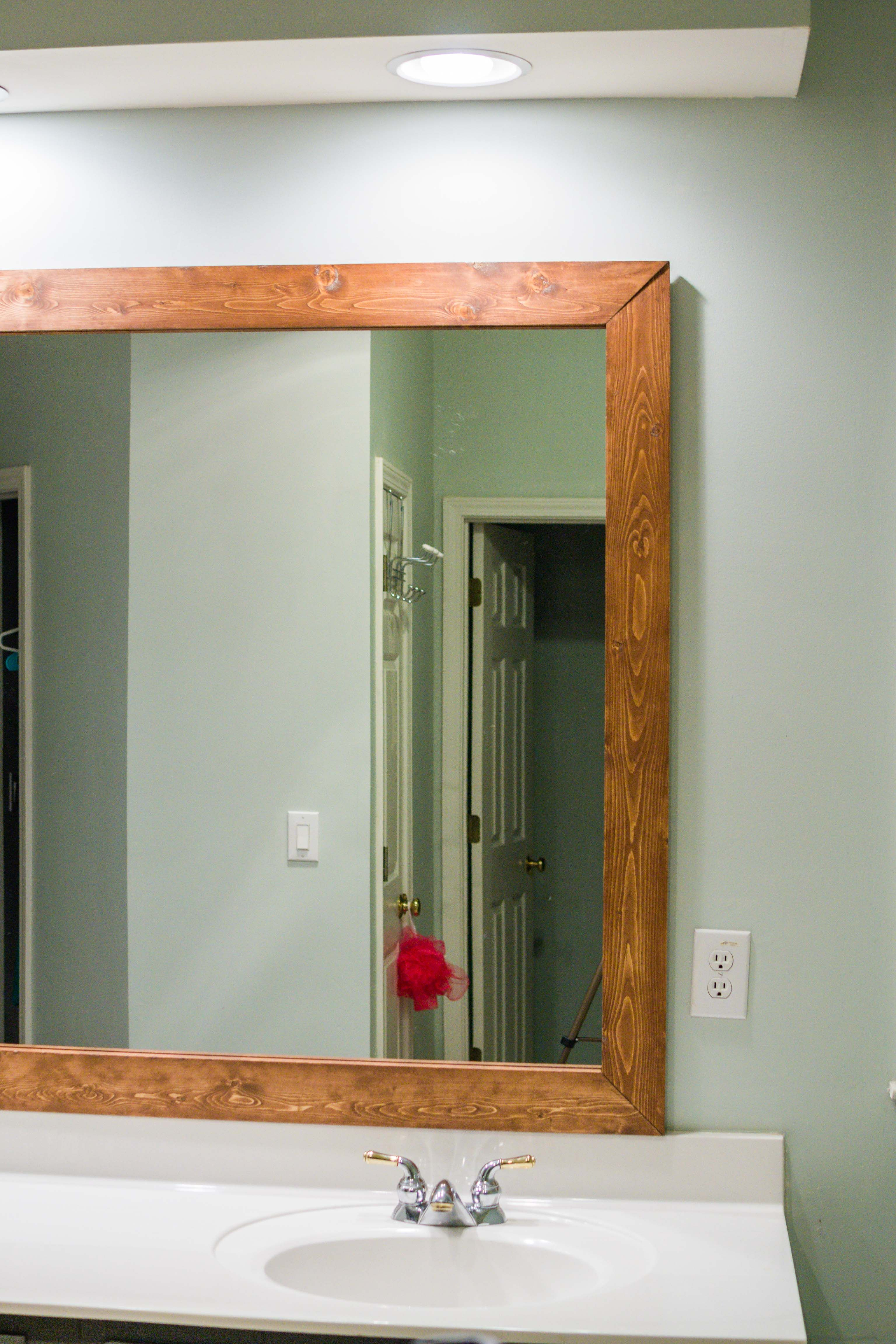 How To Diy Upgrade Your Bathroom Mirror With A Stained Wood Frame