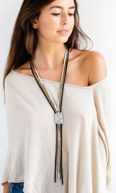 Photo of Statement necklace, Leather necklace, Long necklace, Wrapped necklace, Stylish necklace, Silver necklace, Elegant necklace, Large necklace.