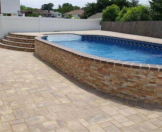 Semi Inground Swimming Pool Designs semi inground pool with decorative brick wall Find This Pin And More On Radiant Pools Backyard Innovators Challenge Radiant Semi Inground