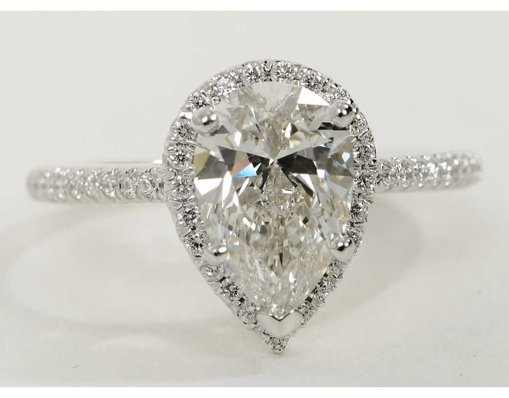 Pear shaped halo diamond engagement ring in k white gold halo