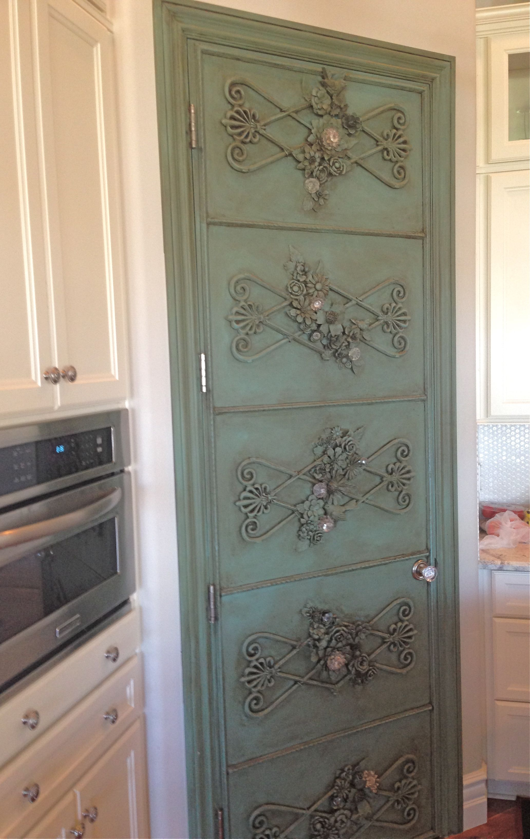 Aqua door with added vintage rod iron trim metal flowers for Wood doors painted trim