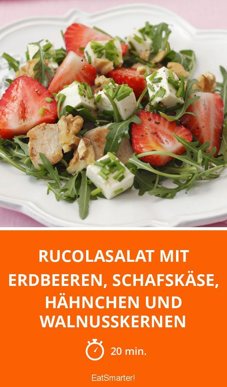 Rocket salad with strawberries sheep cheese chicken and walnut kernels
