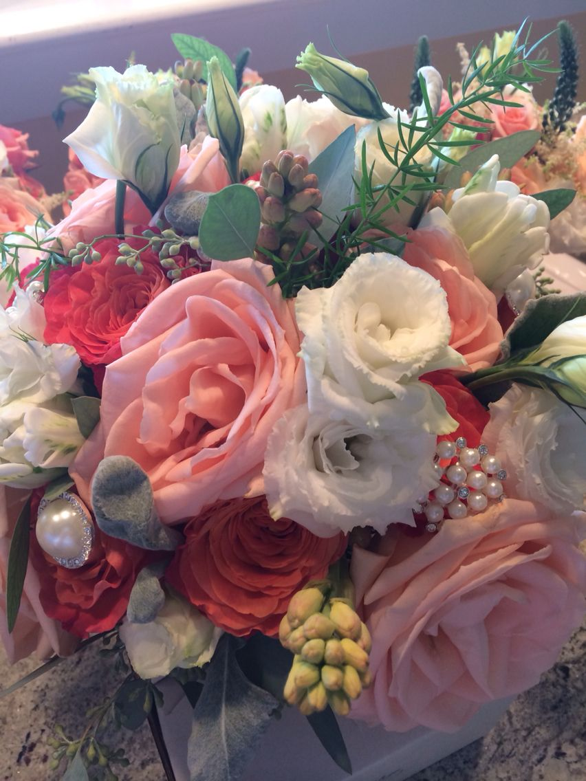 Brides wedding bouquet. Whites, greens, light pinks, and coral ...