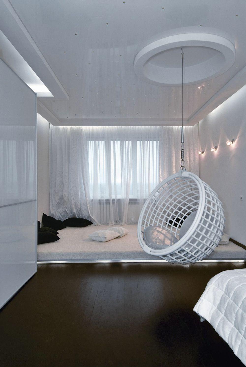 futuristic apartment interior with predominantly white furniture