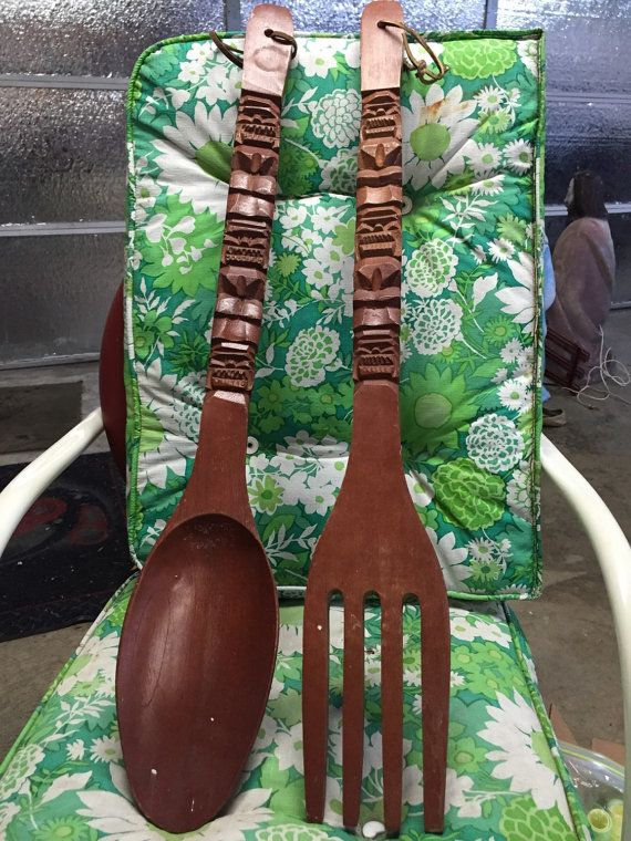 Vintage wooden Tiki spoon and fork! Measures approximately 28 long! Decent vintage condition a few paint spots but thats it. Please feel free to