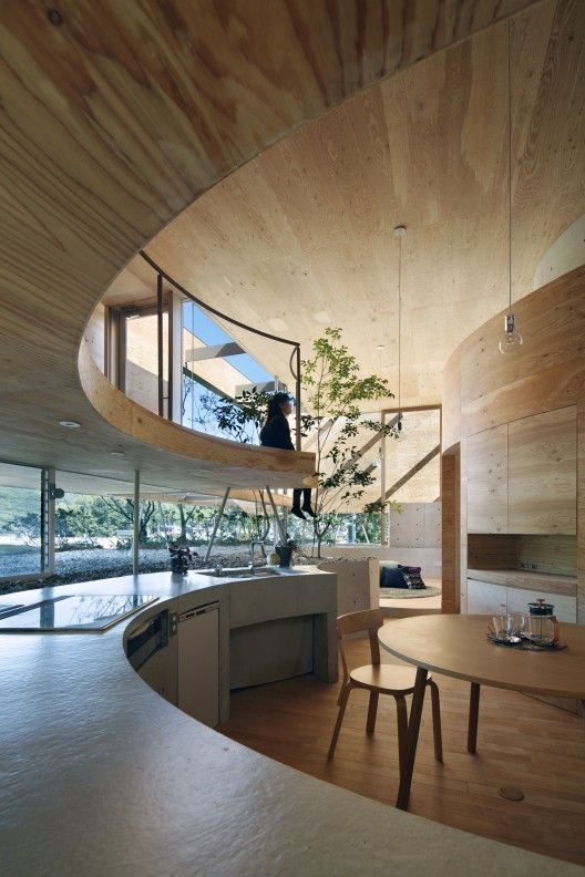 House in Okayama, Japan by UID Architects.    Cylindrical concrete core on the ground connects to a 'floating' wooden box above which comprises the main living space. Interesting spaces!