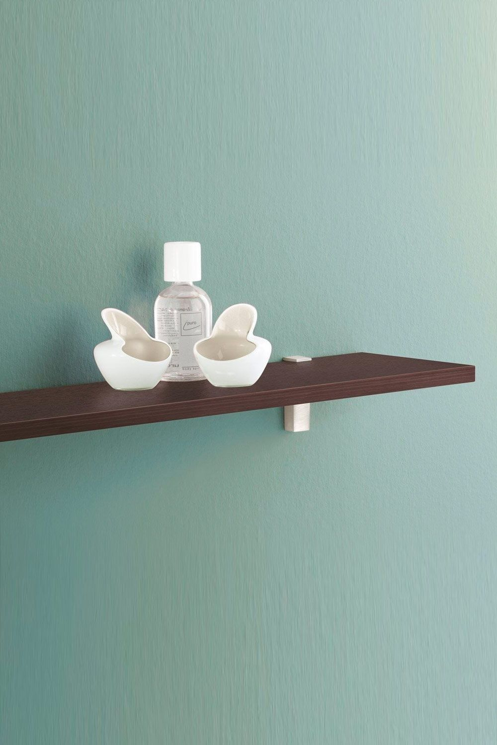 Cosmetics, perfume and towels find plenty of space on wall shelves ...