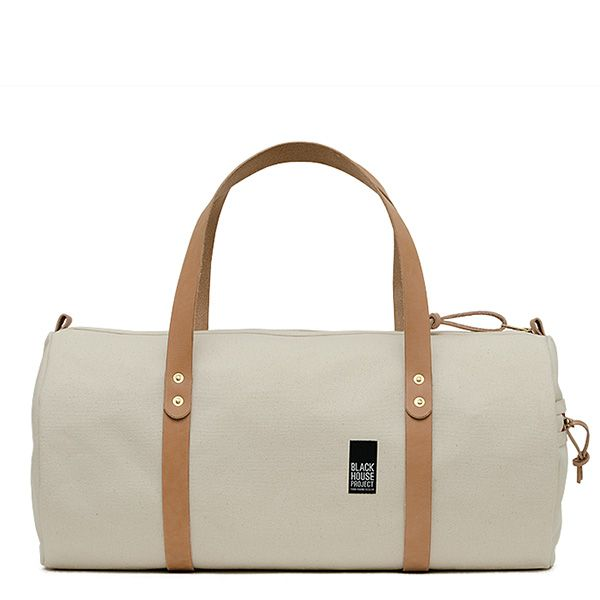 d46480b7210 My take on the classic duffle bag, updated in 18 oz duck canvas. Details  include a side pocket, vegetable tanned leather handles, leather zipper  pulls, ...