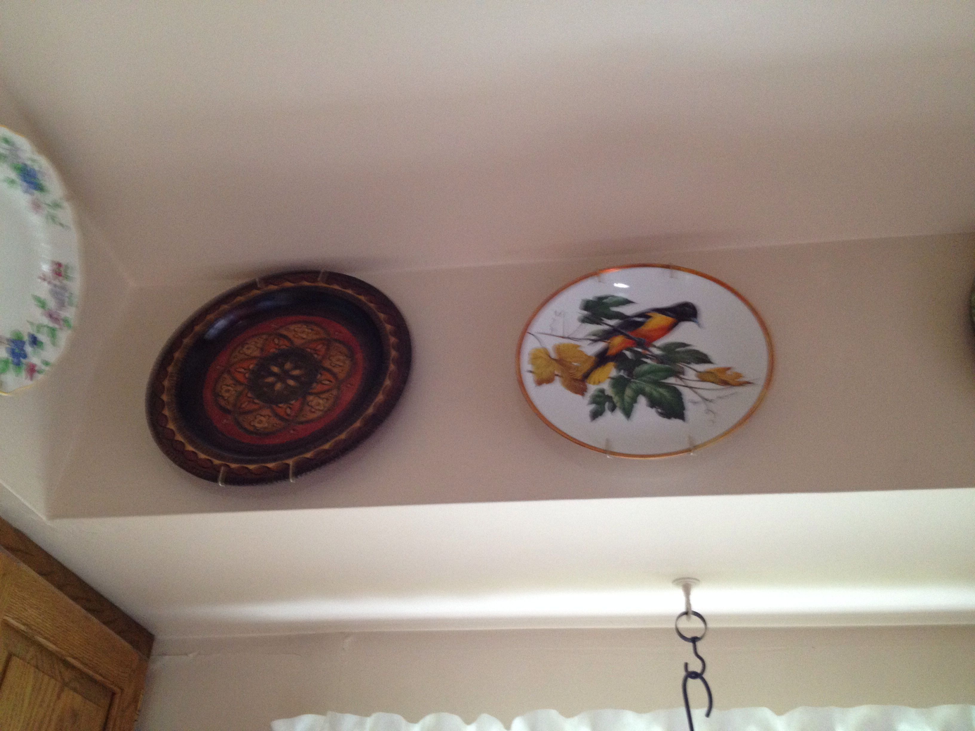 Ukrainian wooden plate and Baltimore oriole plate