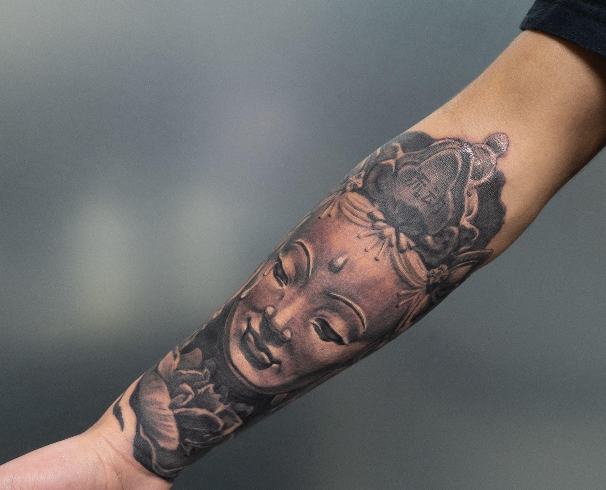 Buddha displayed in black and grey tattoo work tattoos