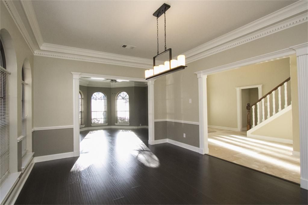 Two tone wall with chair rail and dark hardwood - dining ...