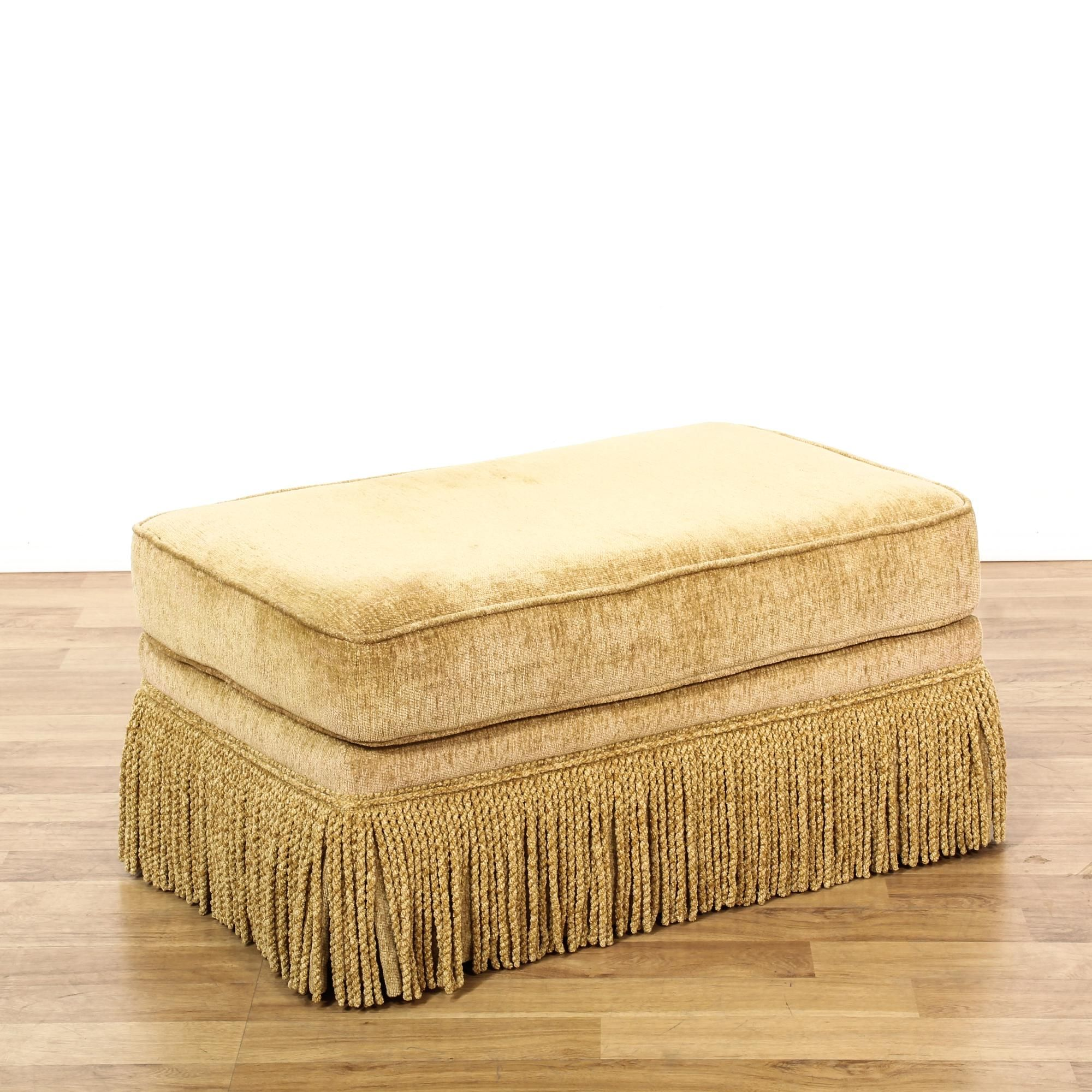 This ottoman is upholstered in a durable velvet with a light tan gold finish. This footstool has a large cushion top with piping trim and a long fringe skirt. Perfect bench for kicking your feet up! #americantraditional #chairs #ottoman #sandiegovintage #vintagefurniture