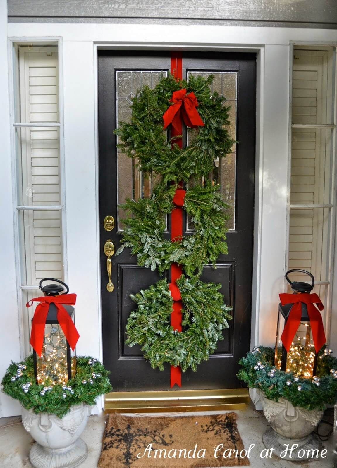 35 Festive Outdoor Holiday Planter Ideas To Decorate Your Front Porch For Christmas Front Door Christmas Decorations Front Porch Christmas Decor Christmas Porch Decor