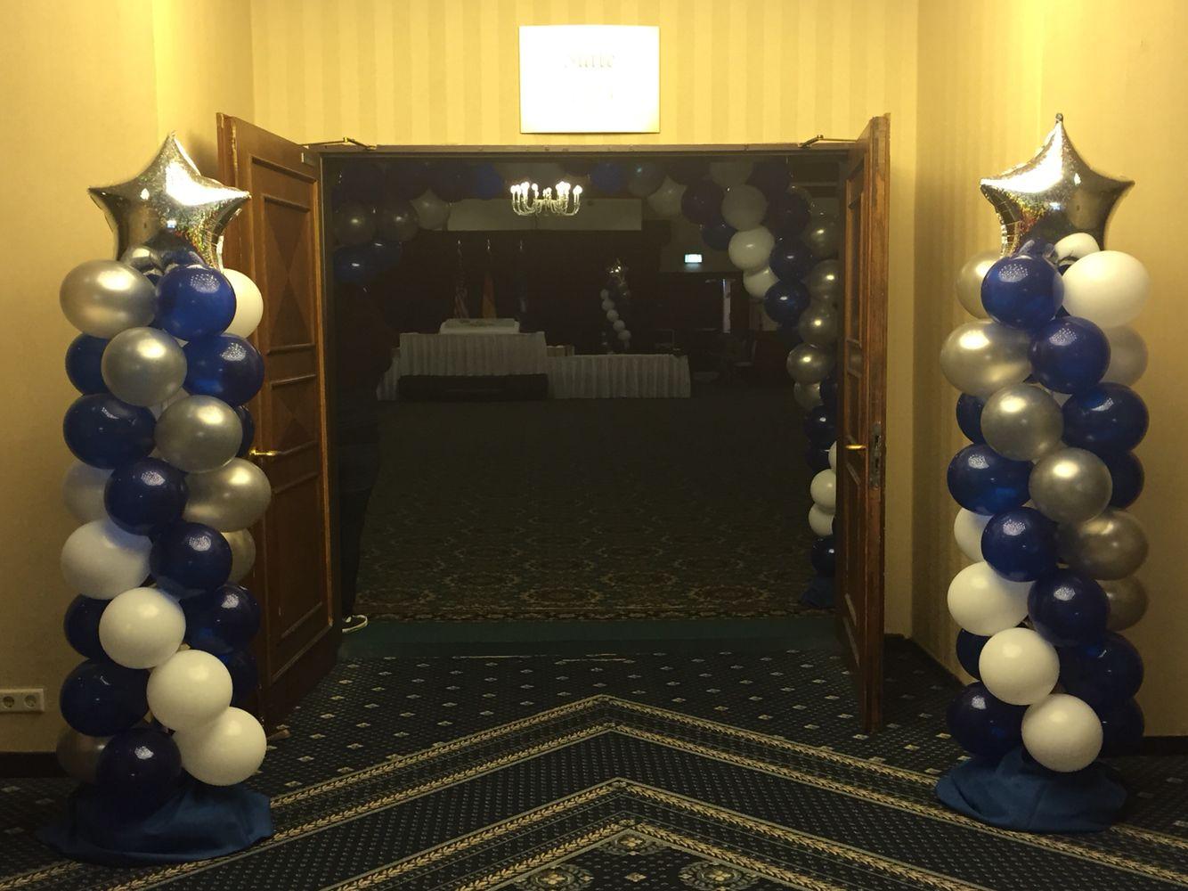 White, blue, and silver balloon columns Dallas cowboys