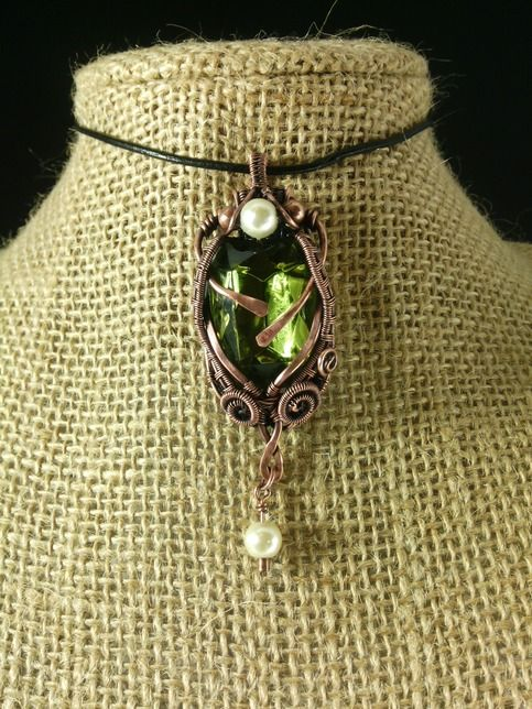 Green multi-faceted Czech Crystal gemstone with the color of peridot. The pendant was wrapped in flowing copper patina finished wire that accents the brilliant green facets of the stone. This is an eye catching pendant.  Custom piece done for a special customer. For illustration purposes only. Not