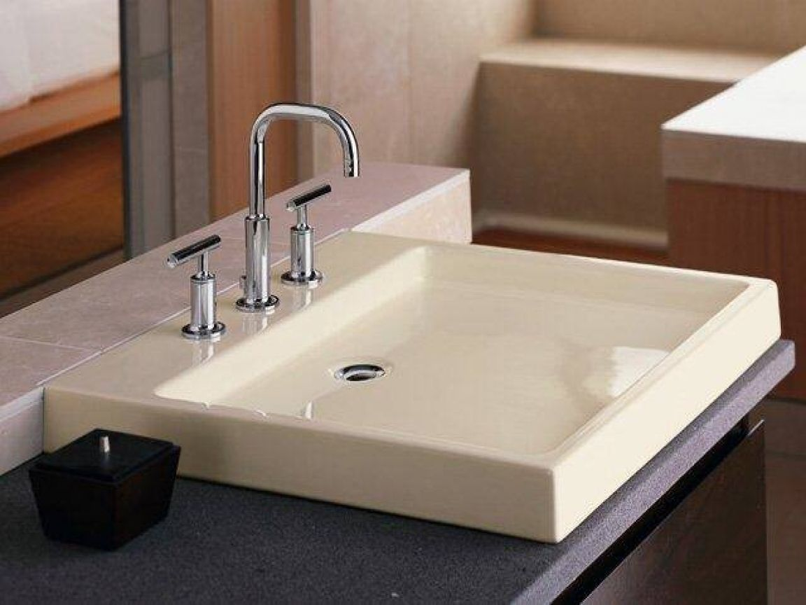 Kohler Kitchen Sinks And A Puddle Of Water In The Bowl House - Kohler top mount bathroom sinks for bathroom decor ideas