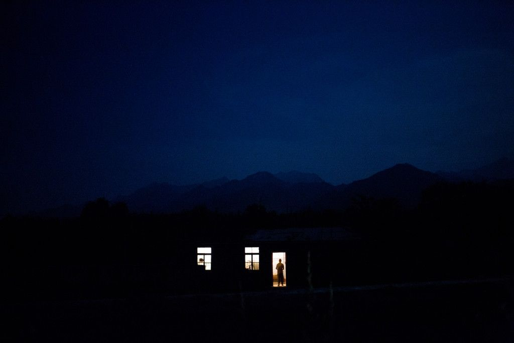 Night falls in the foothills of the Qingling mountain range, where hundreds of small, unregulated gold mines are where hundreds  worked from the late 1990s into the 2000s and contracted silicosis.