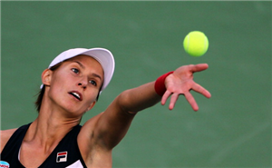 Slovenia's Polona Hercog serves the ball to Daniela Hantuchova of Slovakia during their Dubai WTA Open tennis match in the Gulf emirate on February 21, 2012.
