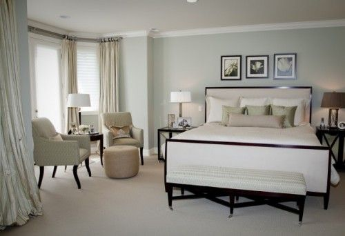 calming color on the walls and bedding. Soft silk striped window treatments frame the bay window and seating area.