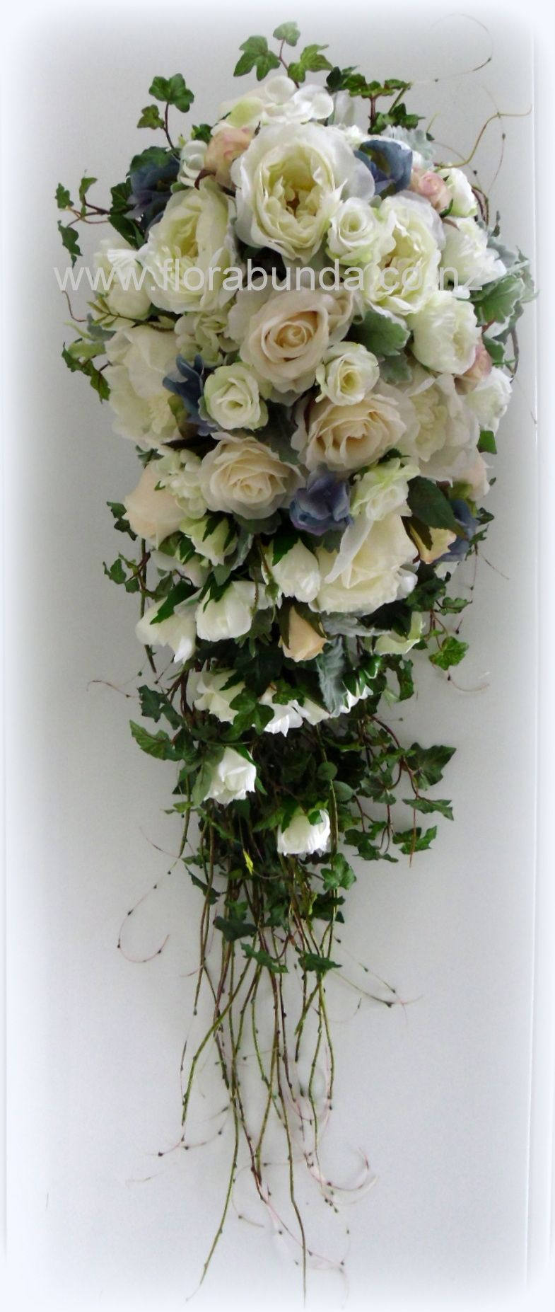 Large trailing wedding bouquet of artificial fake flowers hard to large trailing wedding bouquet of artificial fake flowers hard to tell they are not real izmirmasajfo
