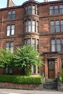 Glasgow apartment building - stained glass in every window ...