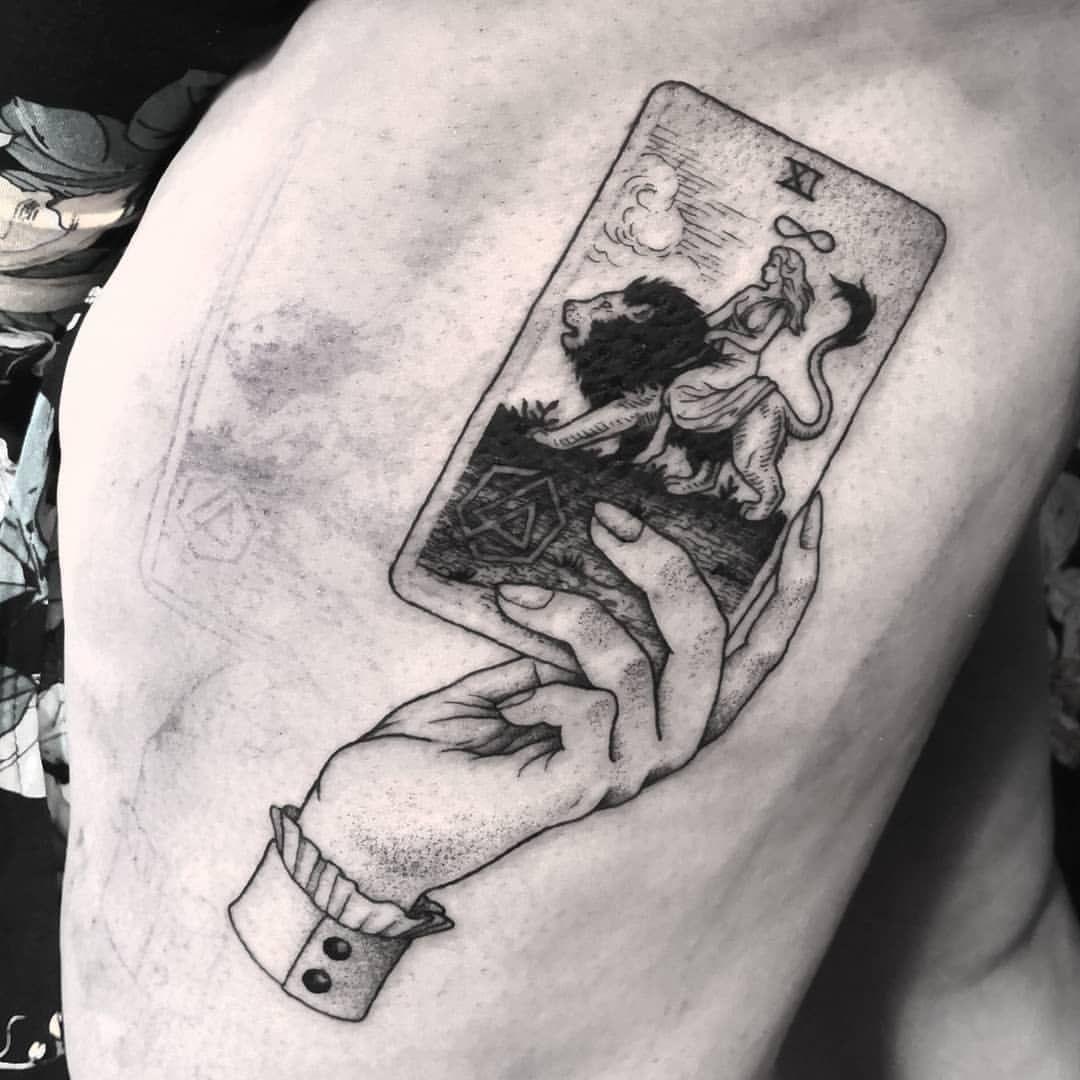 strength tarot card tattoo