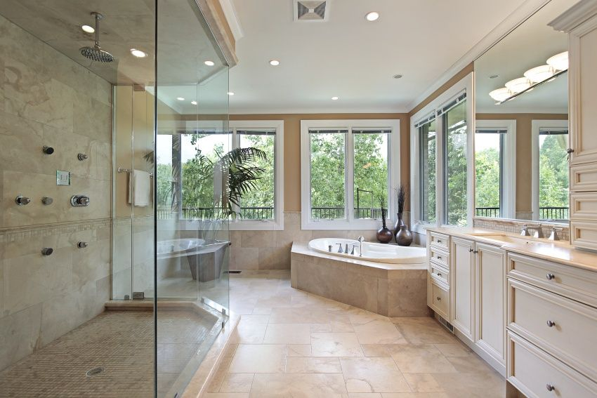 Neutral tones in this bathroom work to highlight the greenery of the  surrounding landscaping outside the large windows. Contemporary white  cabinetry both ...