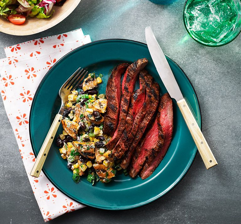 Nothing says summer like a lean flank steak with a chili lime spice rub cooked perfectly on the grill. It pairs perfectly with a grilled sweet potato salad that's sure to become your new go-to side dish! Get our free Slimming World digital magazine via our website to get this recipe and more!