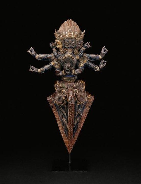 artsexsurvival:  Tibet Ritual Dagger: Vajrakila in Yab-yum, 16th century Copper repoussé over wood.