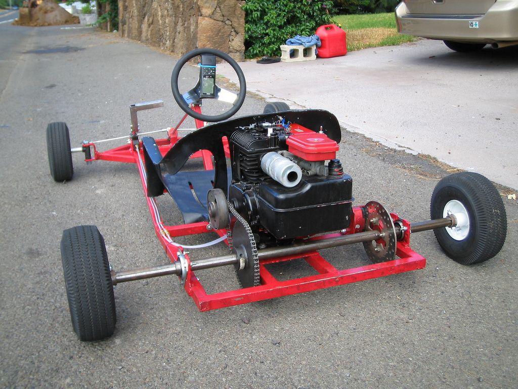 Автомобиль из бензопилы фото