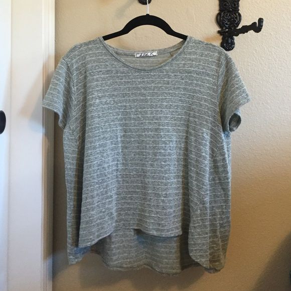 Chloe K striped olive shirt Color is a light olive with white horizontal pinstripes. The cut is somewhat high-low. One of my favorite casual shirts! Chloe K Tops Tees - Short Sleeve