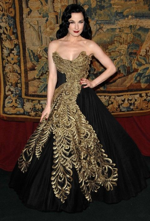 Sensational peacock like black and gold Marchesa gown on Dita Von ...