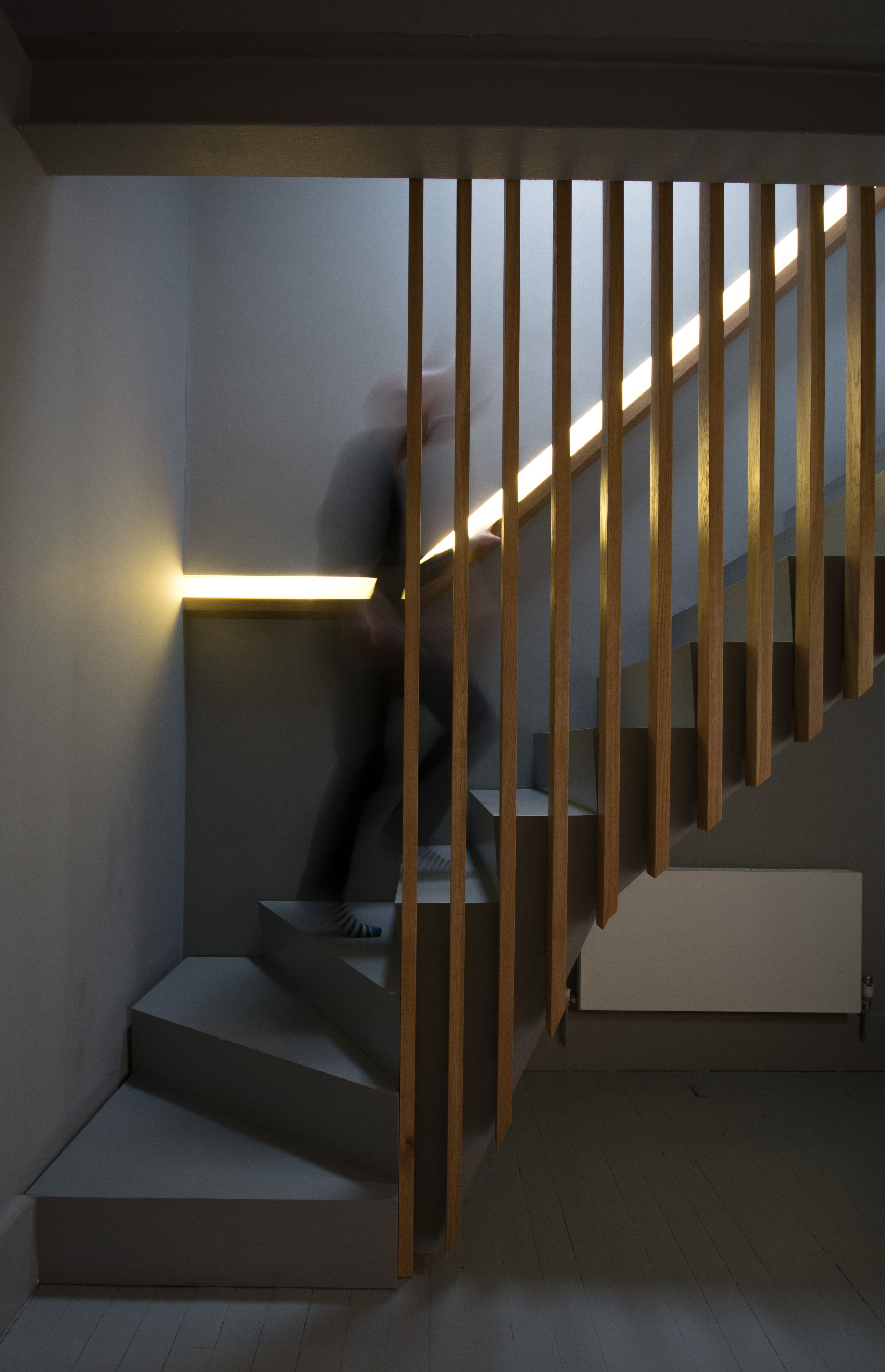 Attractive Oak slatted balustrades against dark grey staircase with recessed  KC36